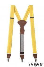 Žlté látkové traky s hnedou kožou a zapínaním na kovové klipy